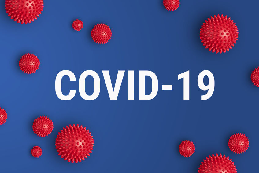 Inscription COVID-19 on blue background. World Health Organization WHO introduced new official name for Coronavirus disease named COVID-19